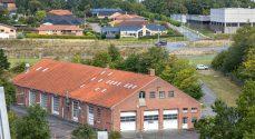 Bitten & Mads Clausens Fond køber kasernens værkstedsbygning